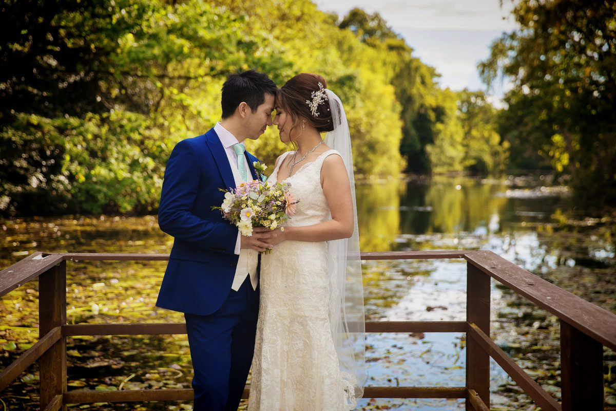 Wedding couple by lake at Stoke Place Hotel