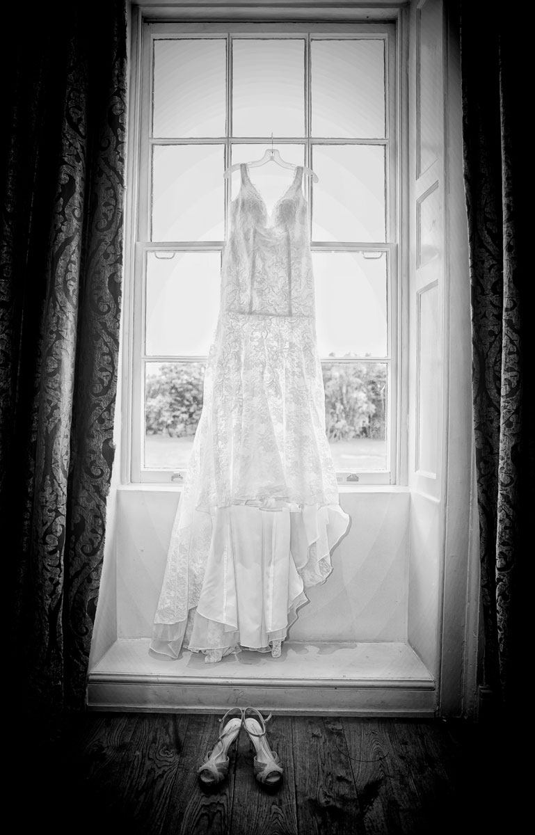 Wedding dress hanging at Stoke Place Hotel