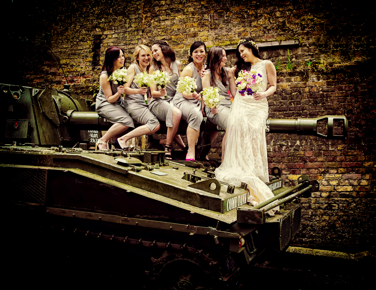 Bridesmaids sit on tank again at London Islington wedding day image