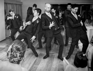 Groomsmen dance at Stokes Hotel wedding reception