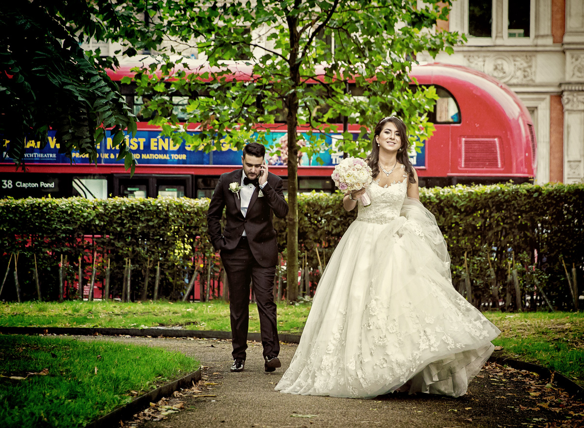 Bride and groom walk through London park after Connaught Rooms wedding