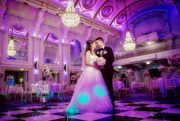 Couple dance and laugh at Connaught Rooms wedding reception