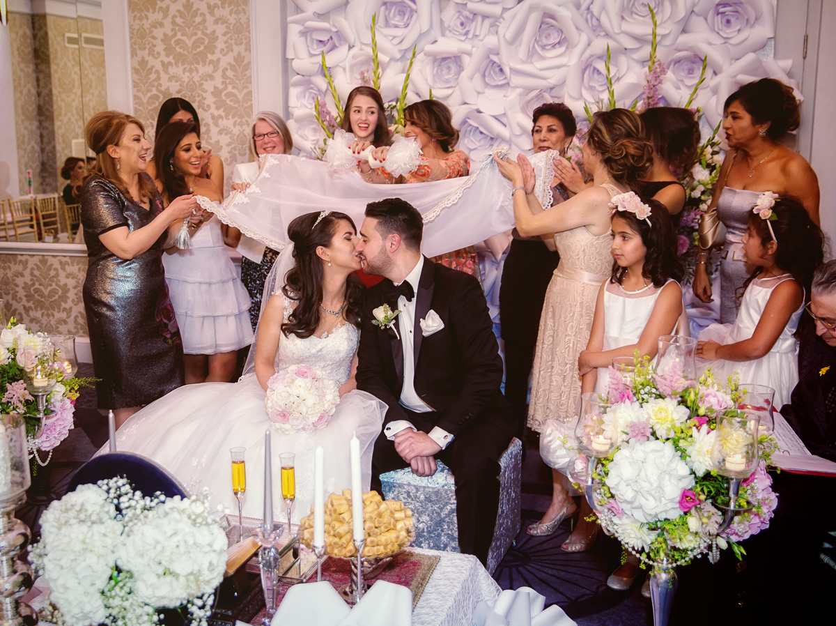 Persian wedding kiss London Connaught Rooms ceremony