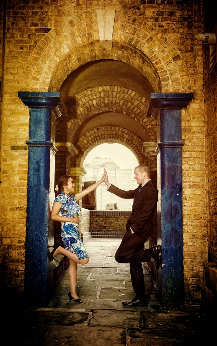 Engagement photo by arch at Londons Butlers Wharf