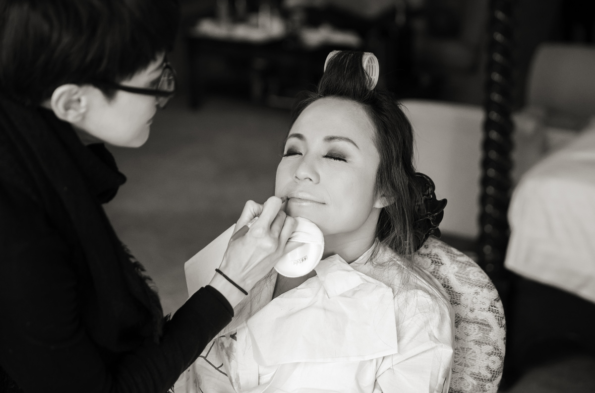 Bride getting makeup for Hanbury Manor wedding day
