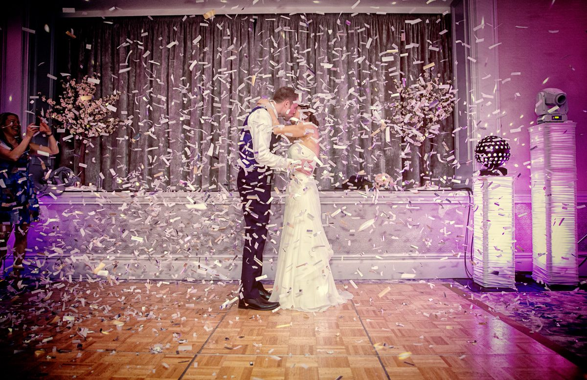 Confetti cannon explodes during Hambury Manor wedding first dance