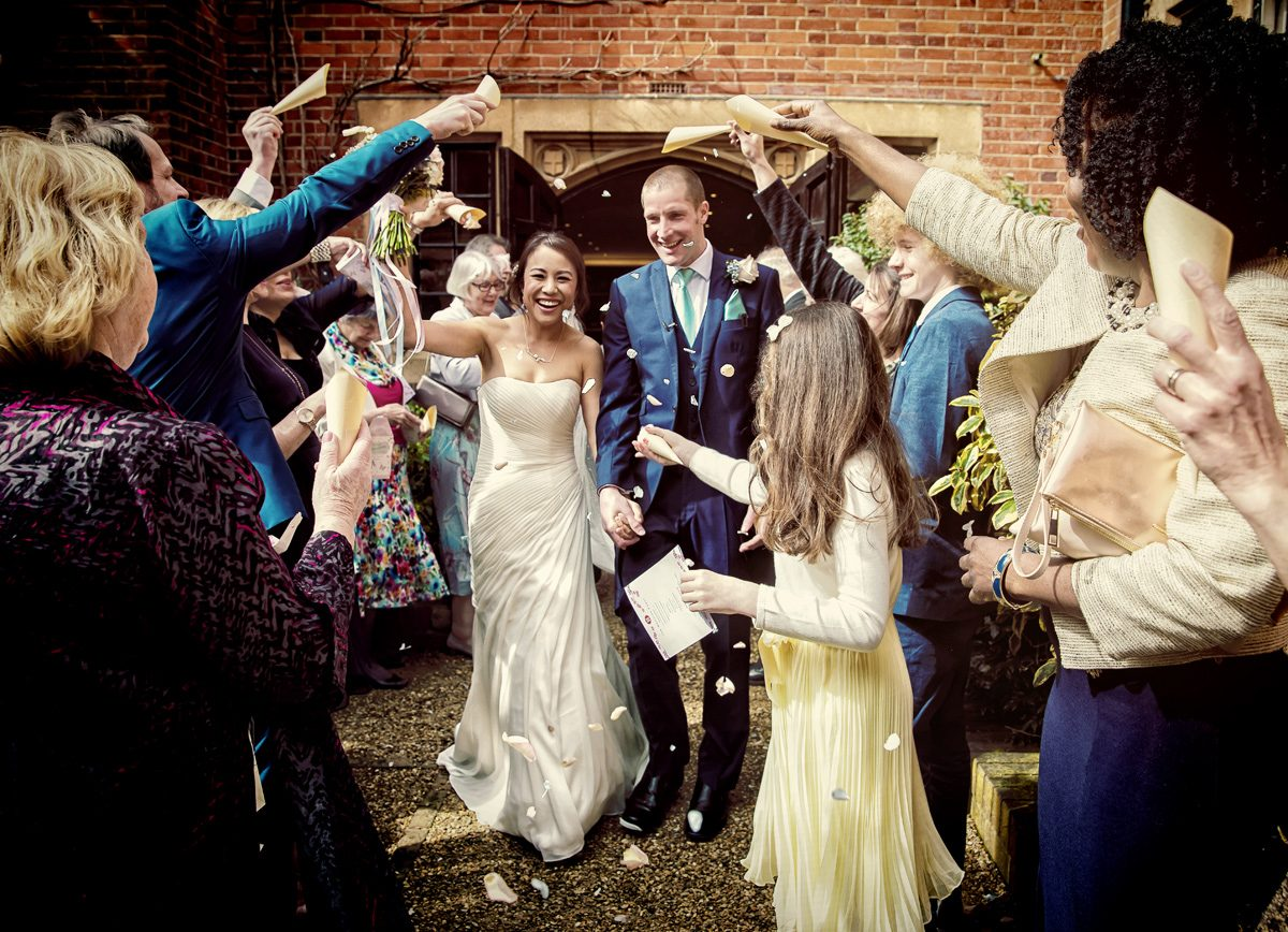 Confetti throw at Hanbury Manor wedding day