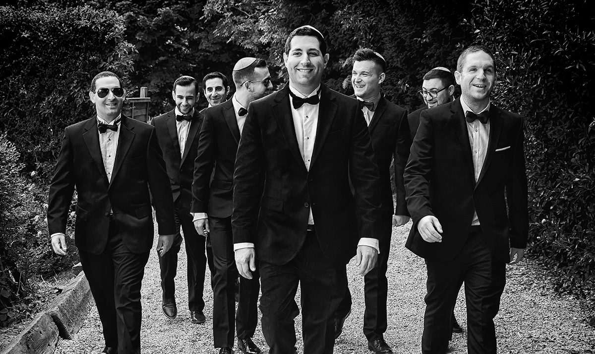 Groomsmen walking to Shendish Manor wedding