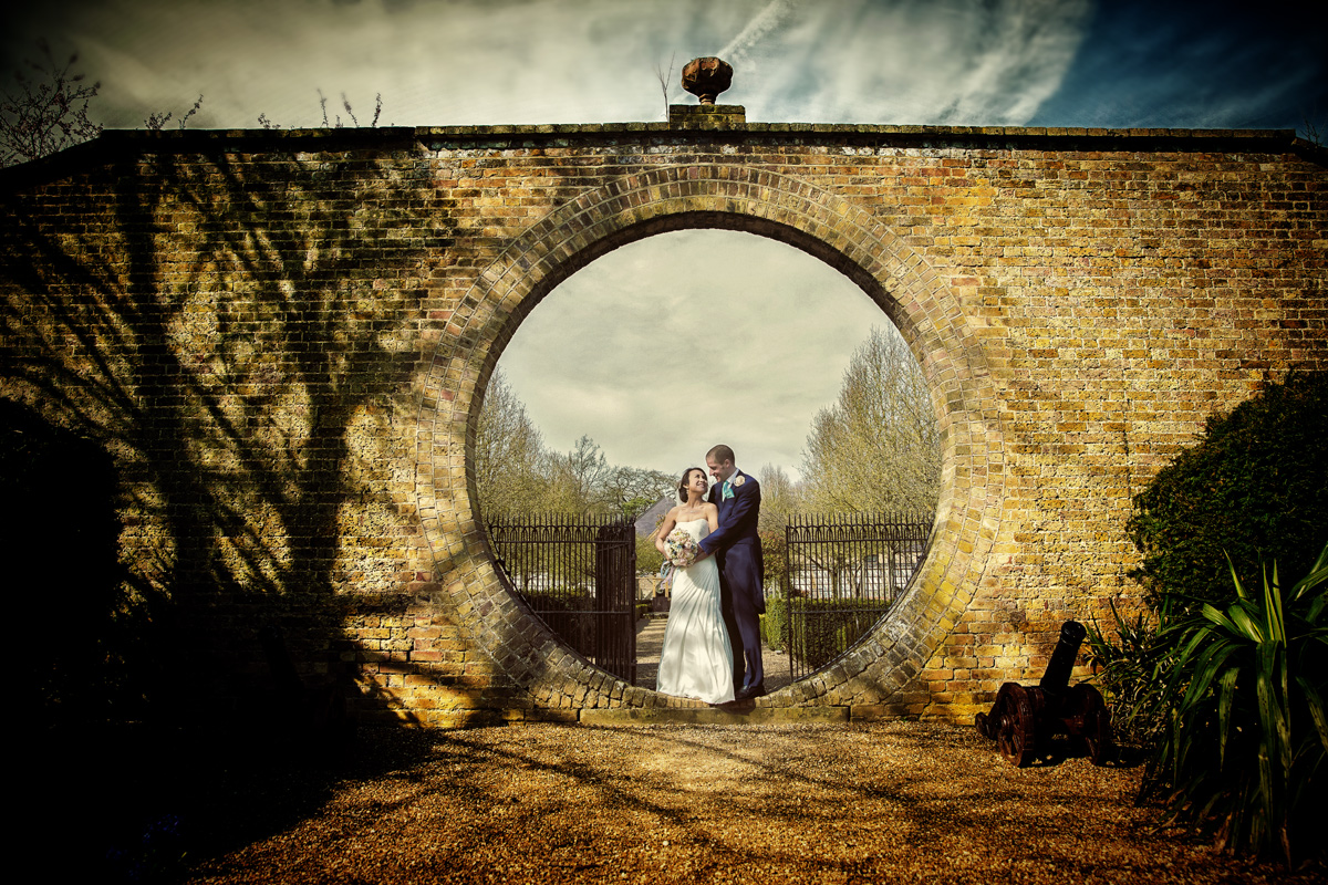 Hole in the wall wedding at Hanbury Manor