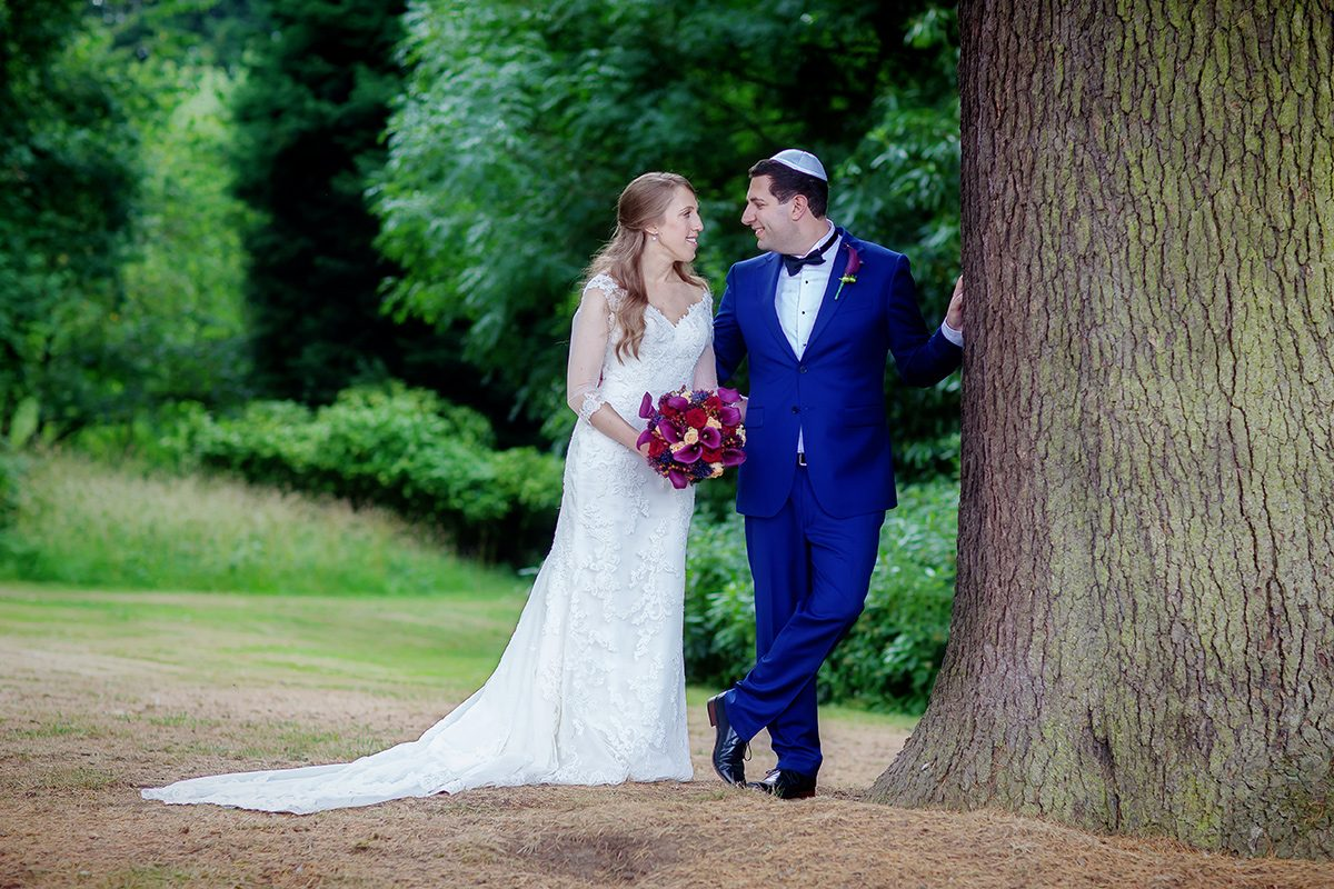 Wedding couple by tree at Shendish Manor