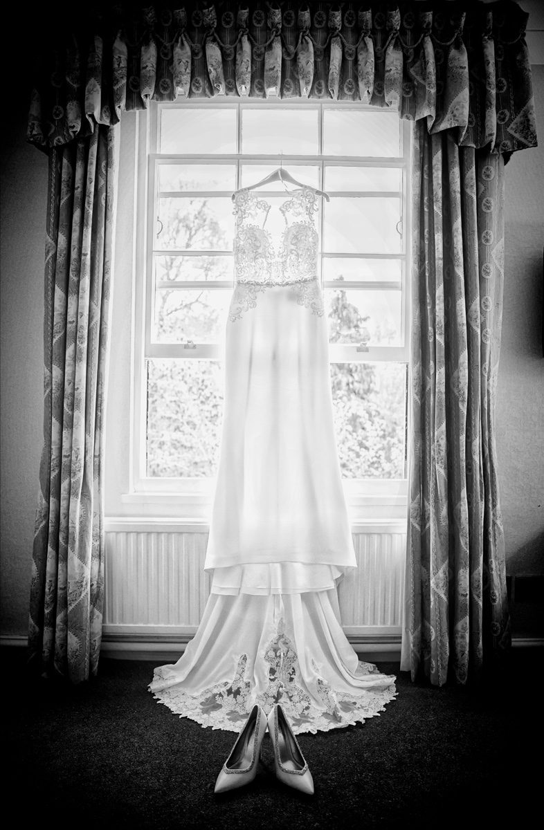Wedding dress hanging at West Lodge Park Hotel