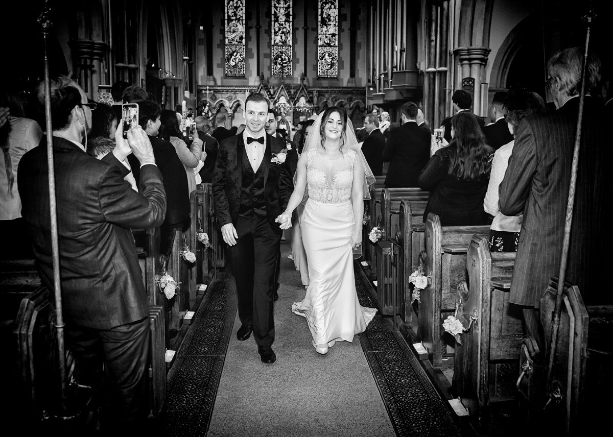 Wedding recessional bride and groom Christ Church Southgate