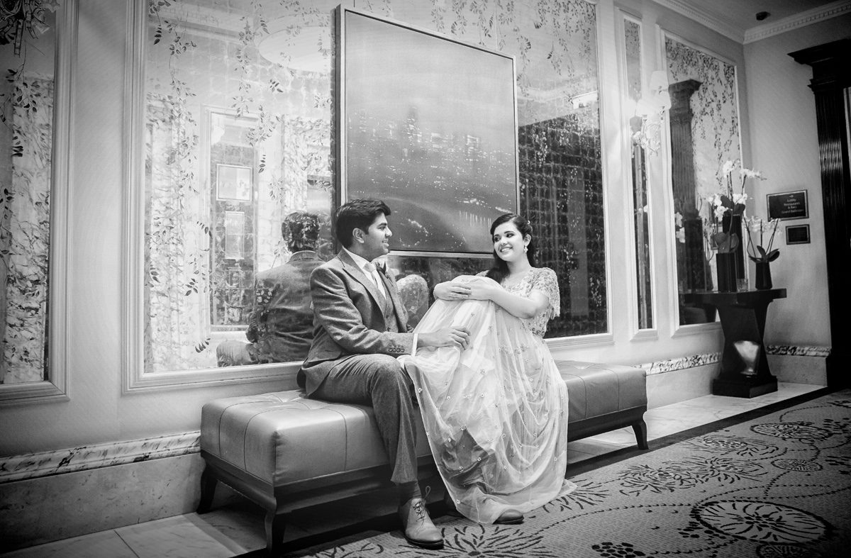 Bride and groom sitting at Langham Hotel wedding reception