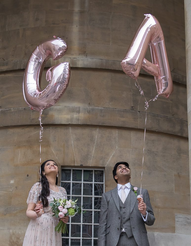 Langham Hotel wedding couple holding balloons