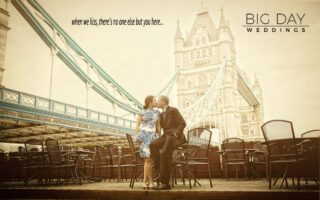 Wedding couple kiss under Tower Bridge London photo