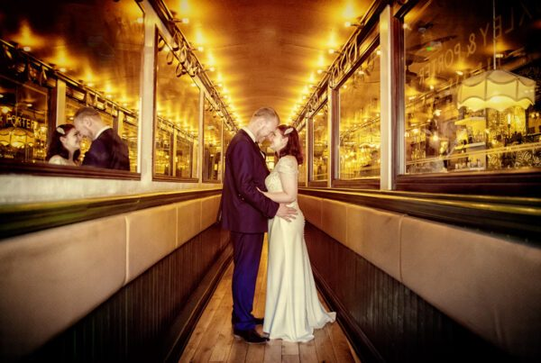 Islington wedding couple pose at Hoxley & Porter Upper Street