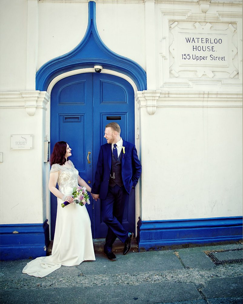 Bride and groom by blue door Islington wedding