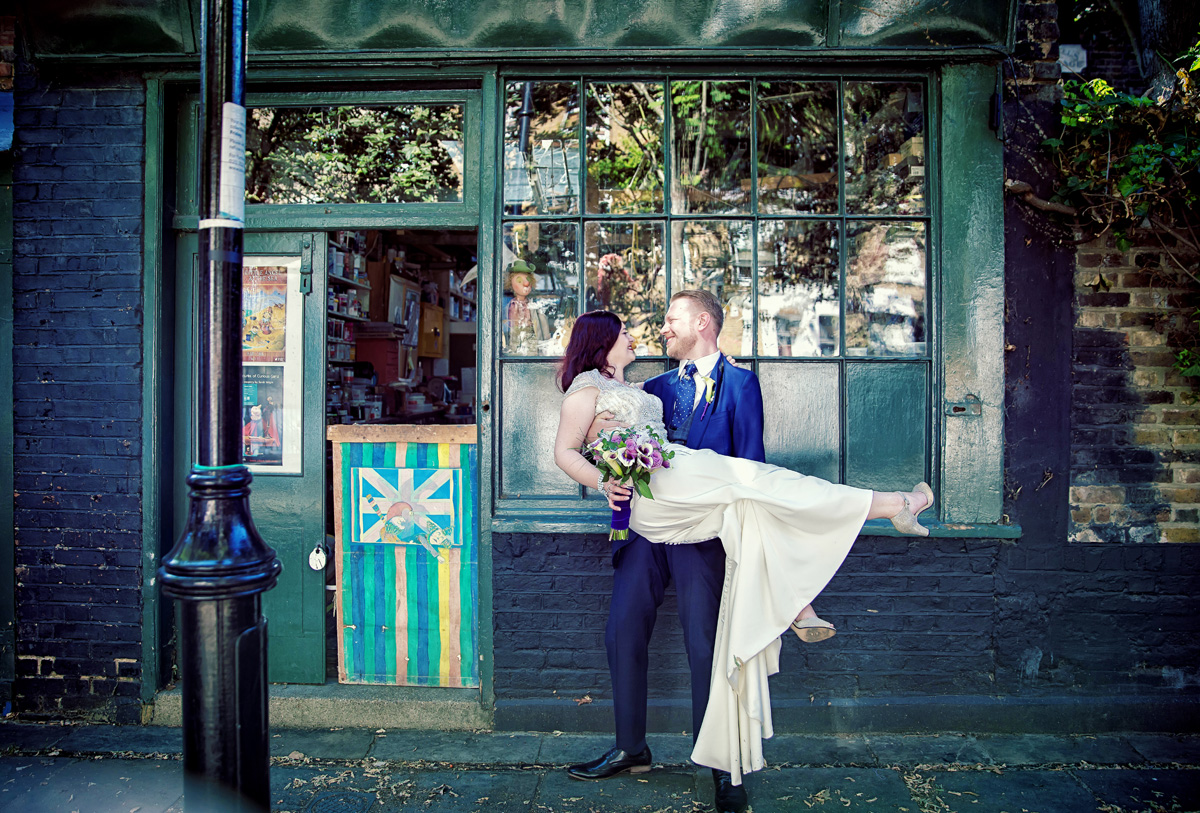 Islington Town Hall wedding couple outside a shop image