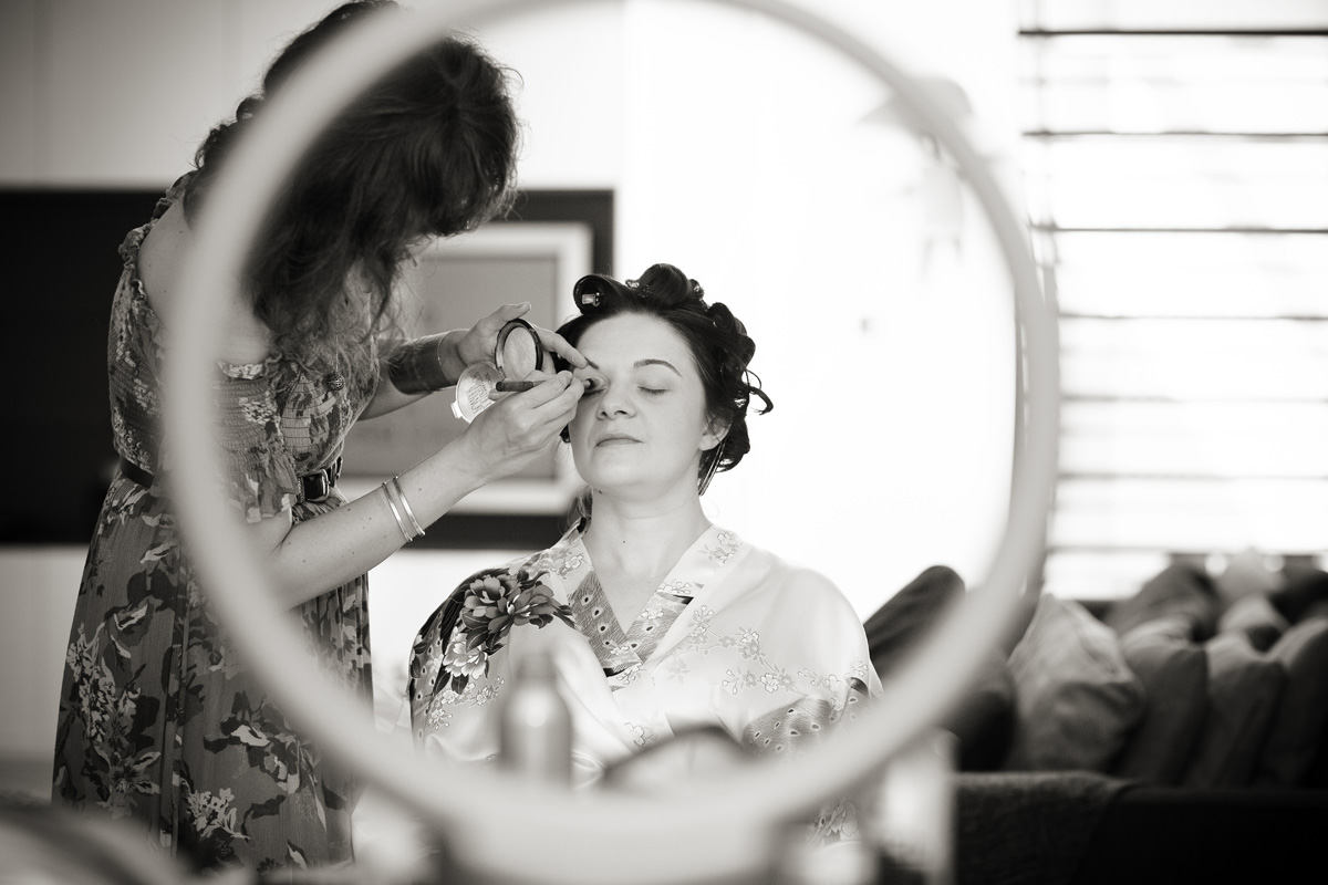 Islington bride getting ready shot through circle image