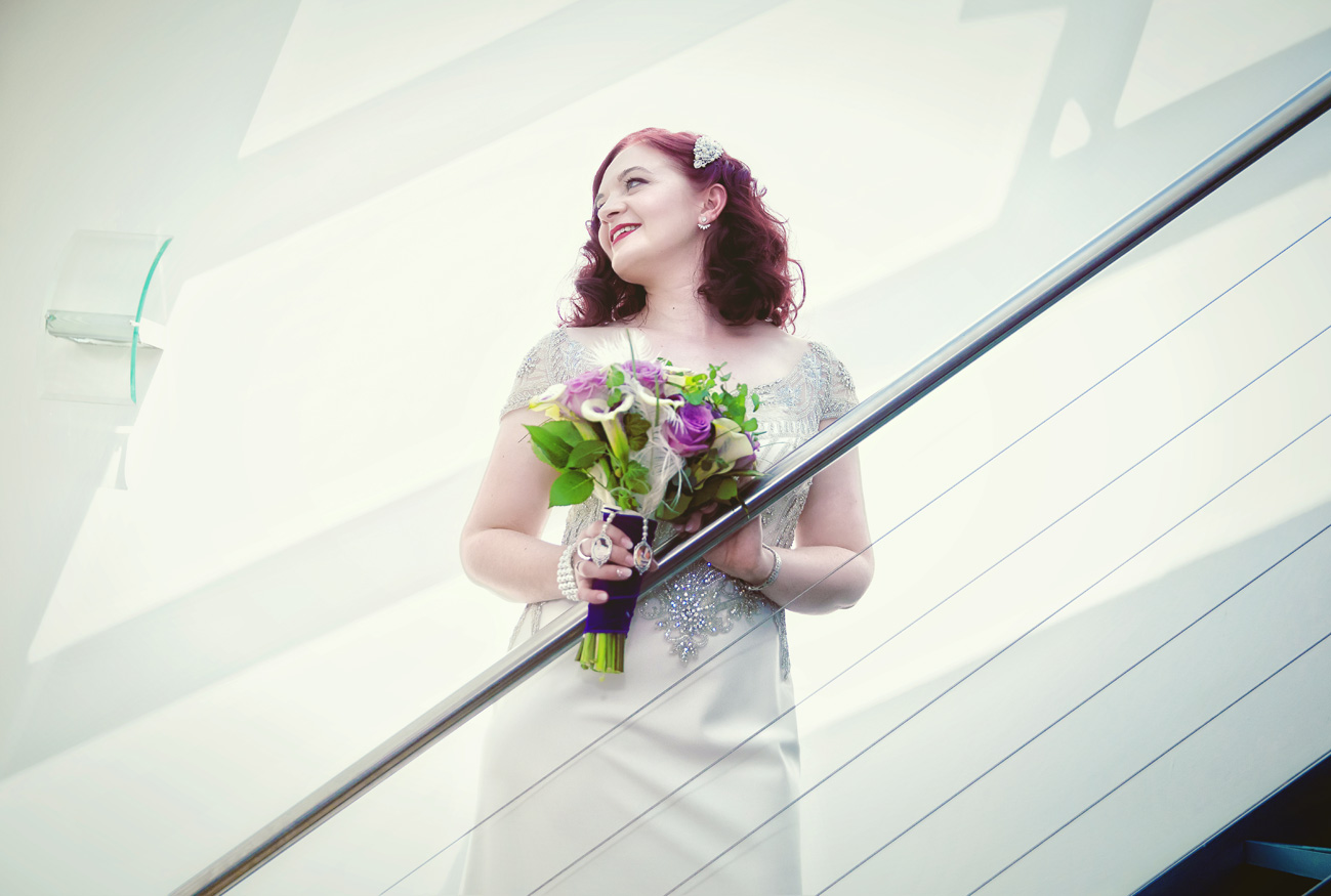 Islington wedding bride poses on metal stairs