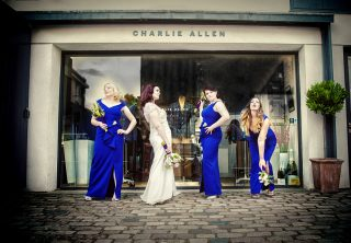 Islington wedding brides pose in front of London clothes shop