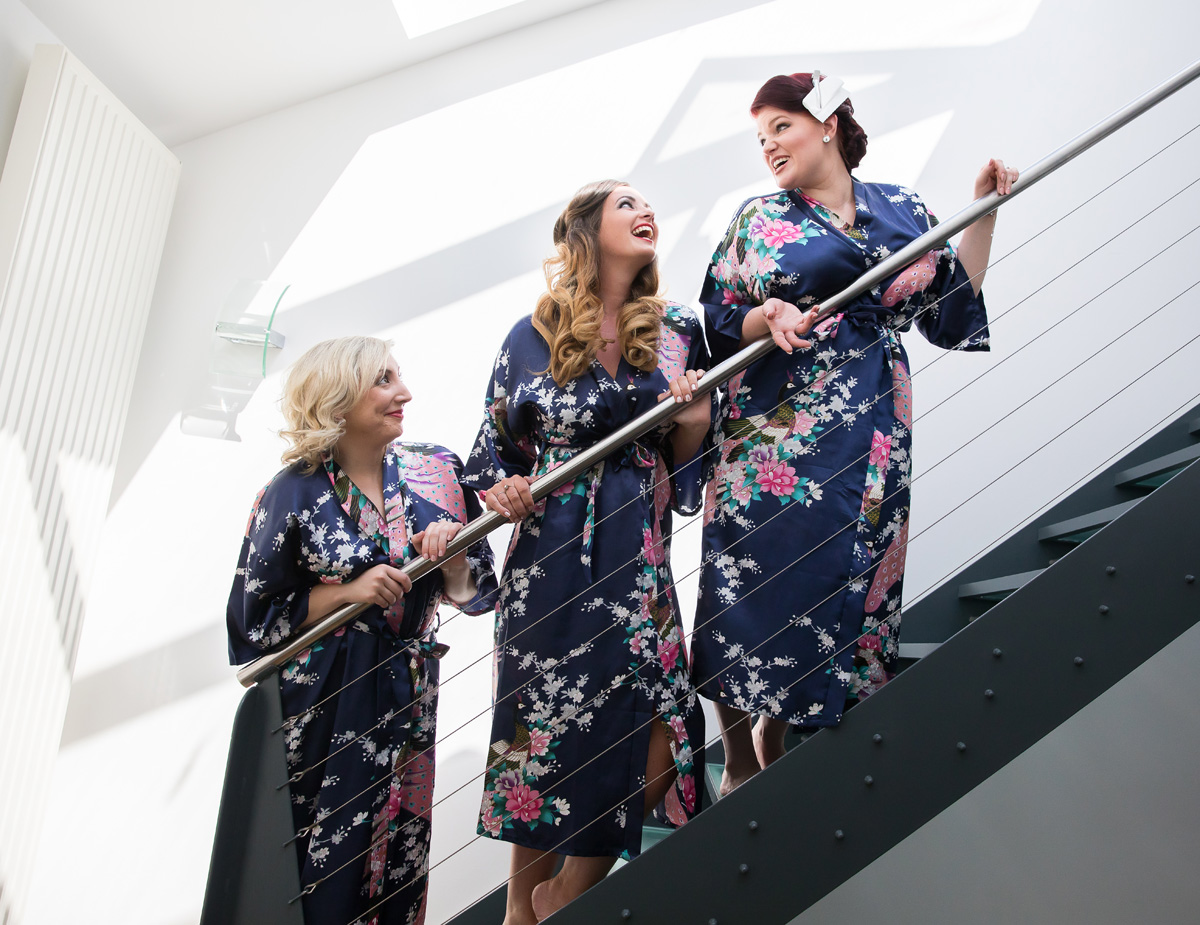 Islington wedding bridesmaids laughing on stairs