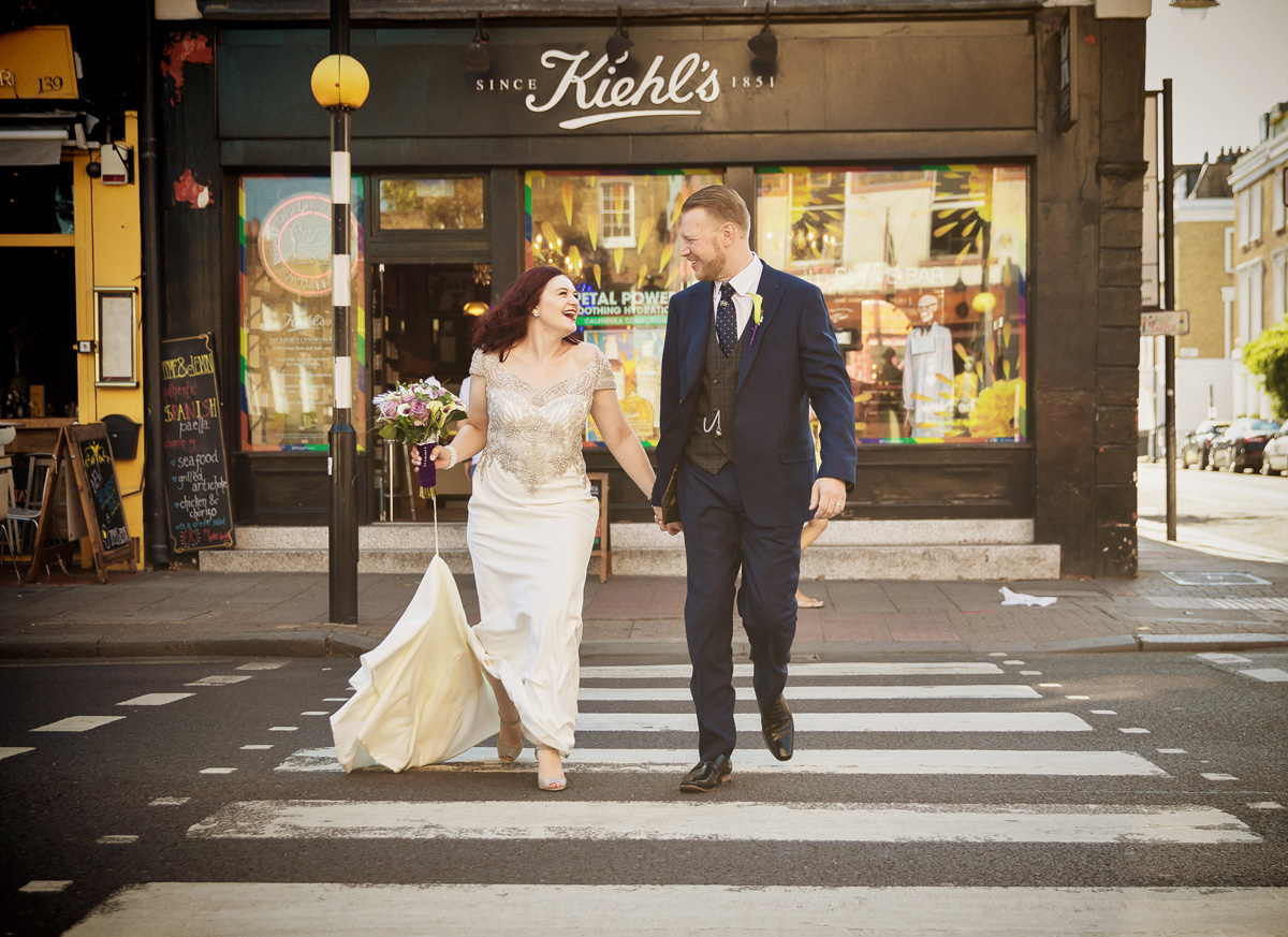 Islington wedding couple crossing Upper Street London
