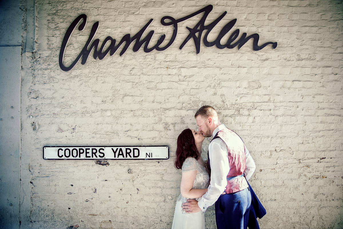 Islington wedding couple kiss by The Dead Dolls House venue