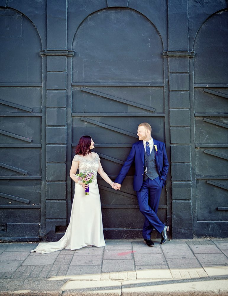 Islington wedding couple pose on Upper Street