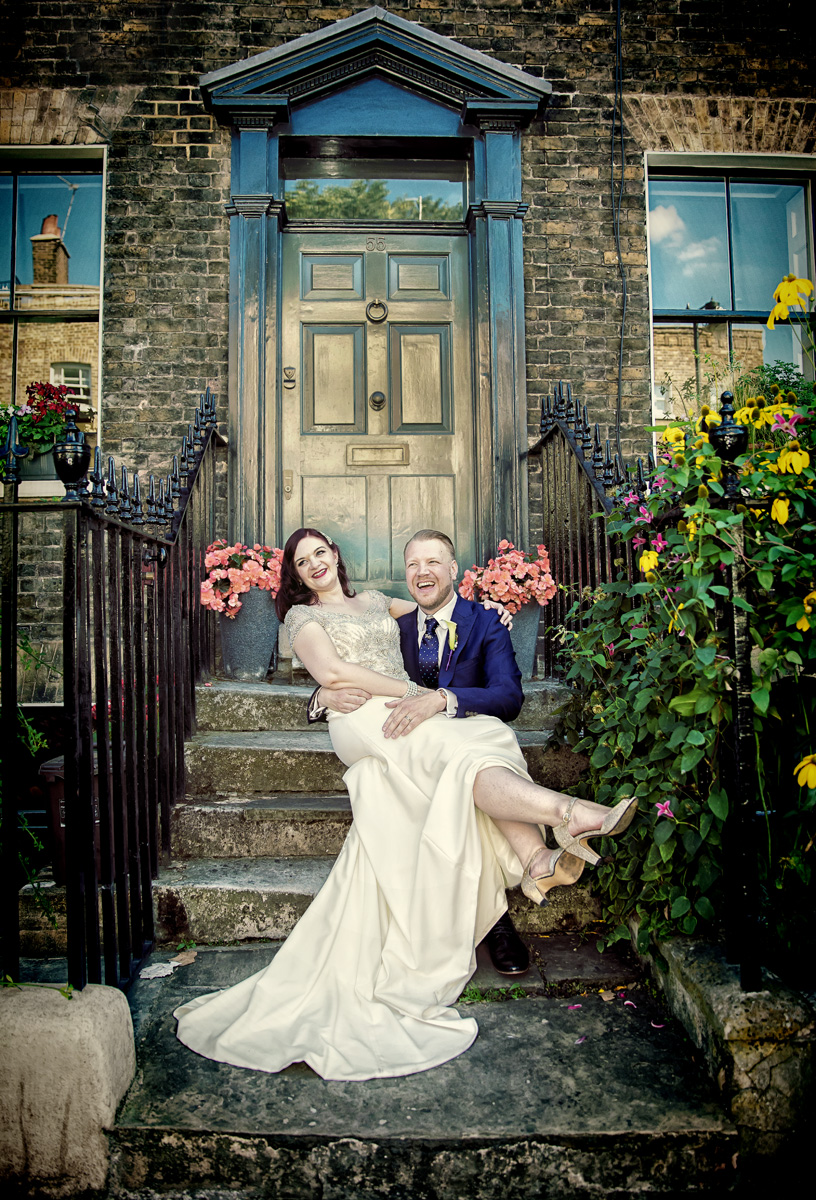 Islington wedding couple sit and laugh on London steps image