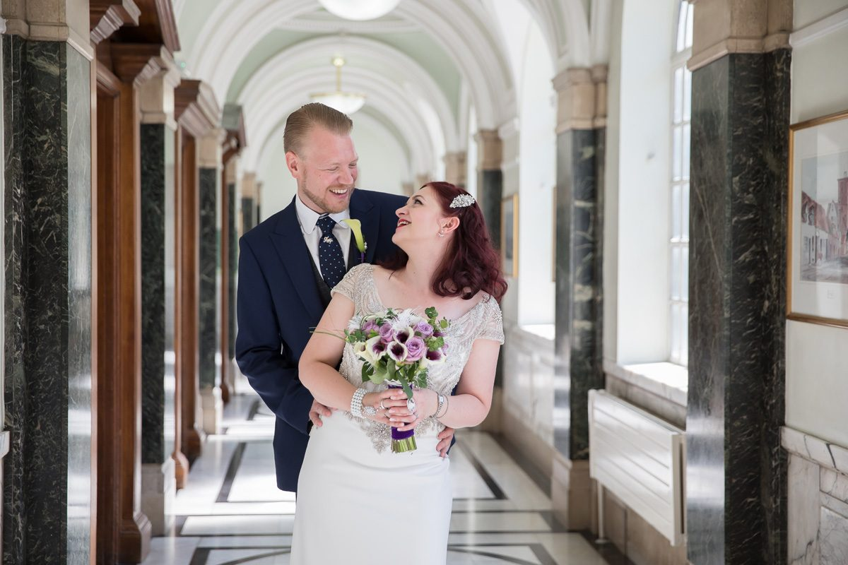 Wedding couple inside corridor Islington Town Hall