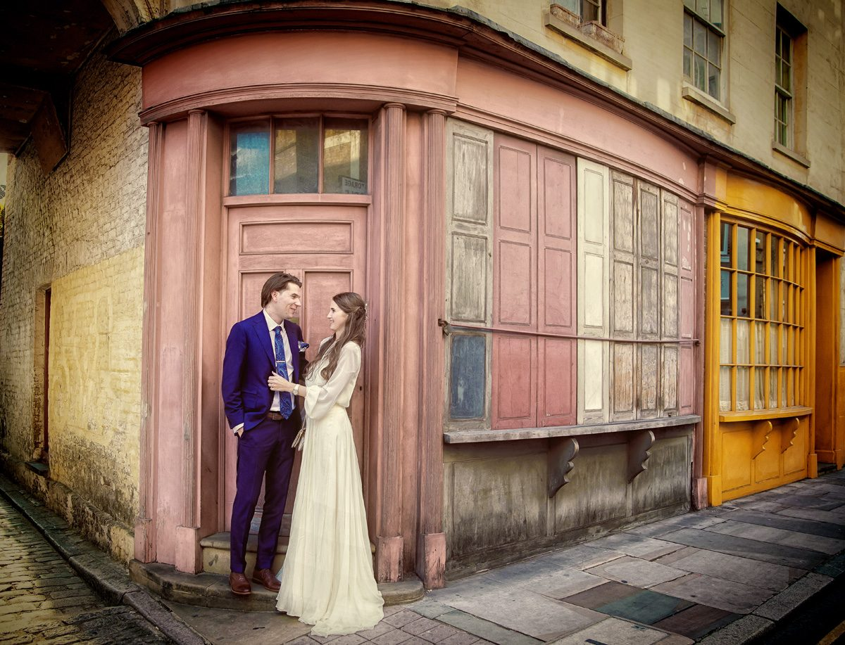 London wedding couple by old shops Bermondsey Tanner Warehouse