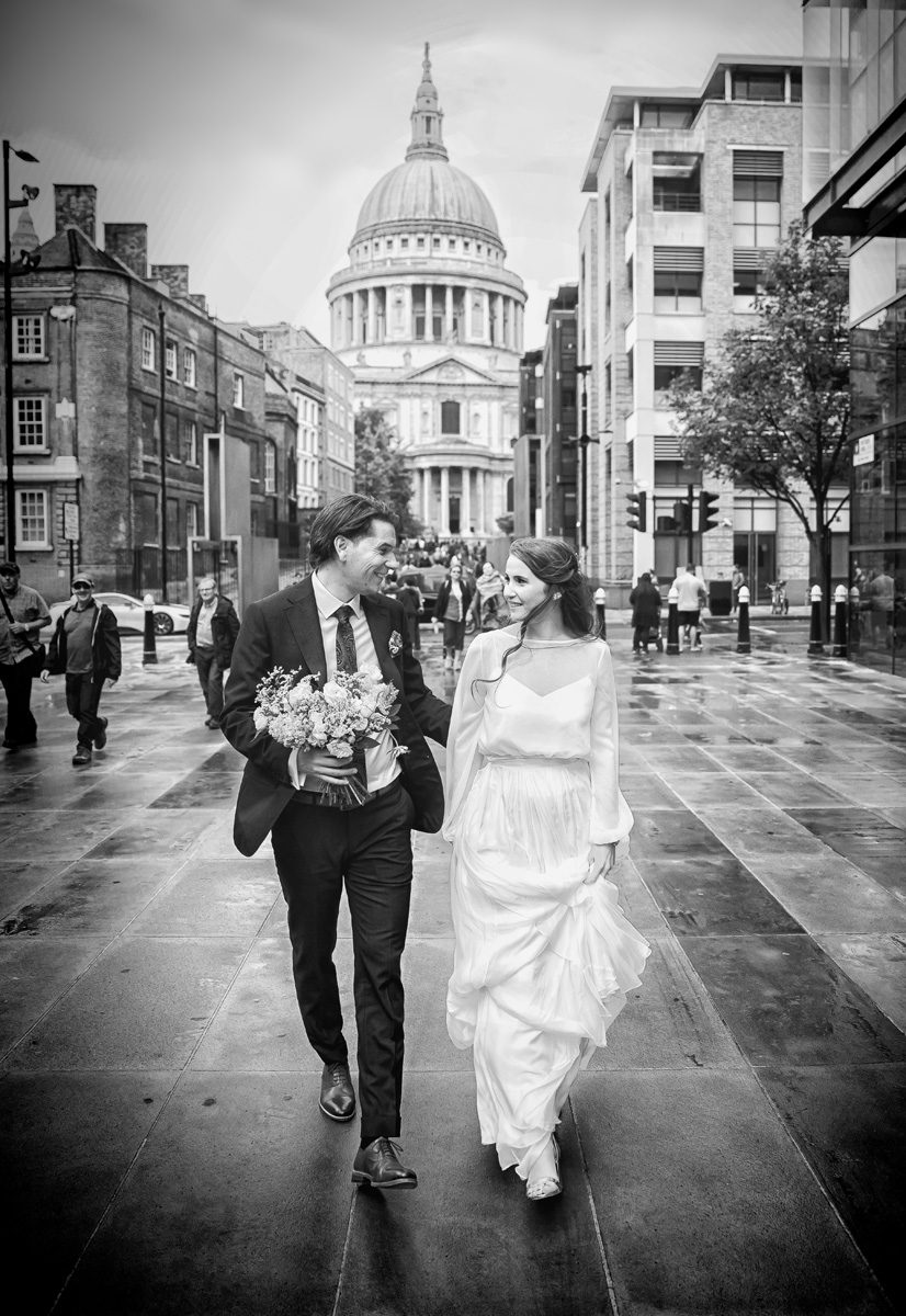 London wedding couple head towards the Millennium bridge