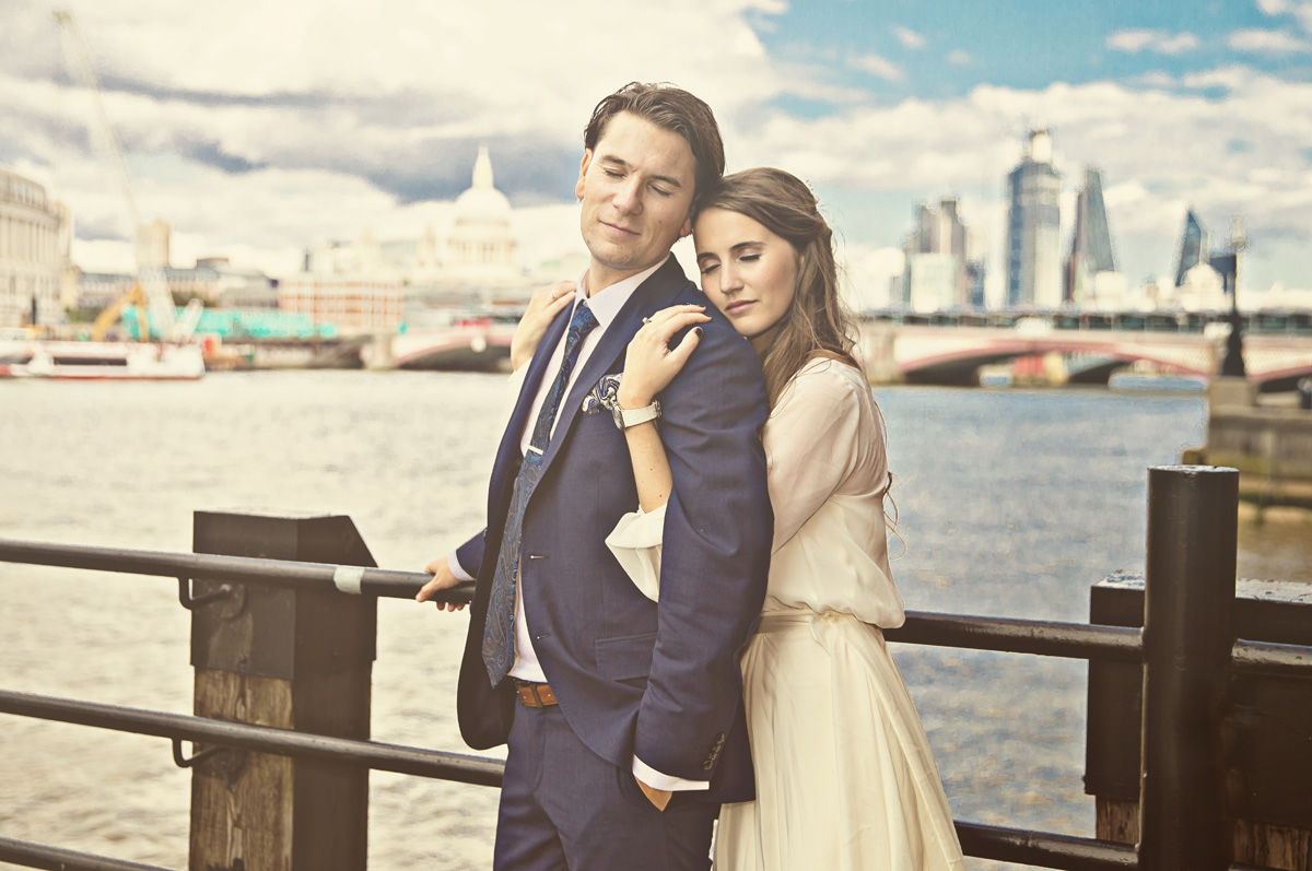 London wedding couple hug by Thames at Southbank photo