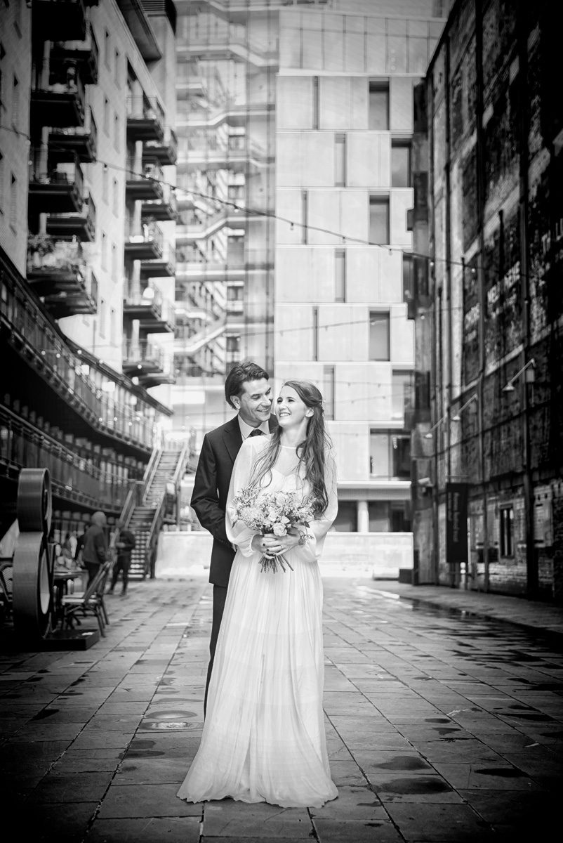 London wedding couple near Oxo Tower laughing