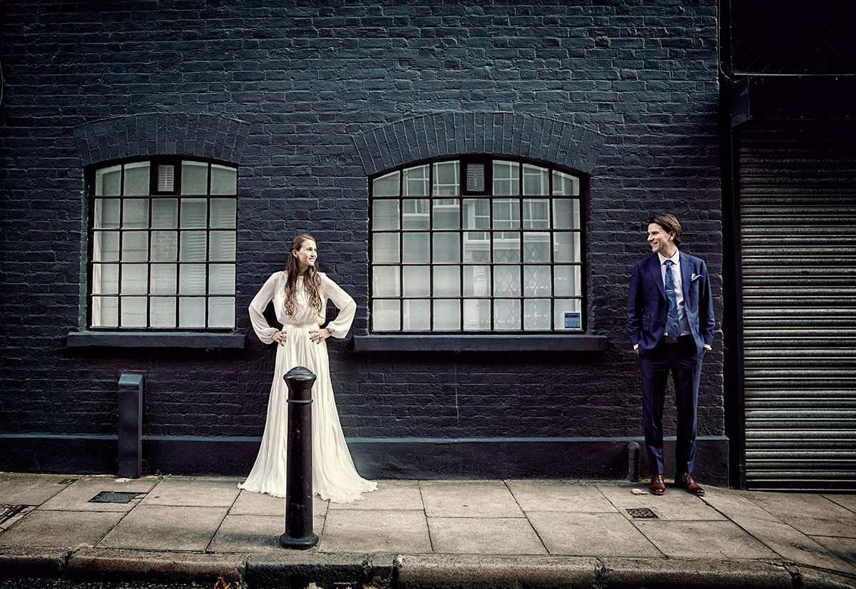 Tanner warehouse wedding couple pose in street