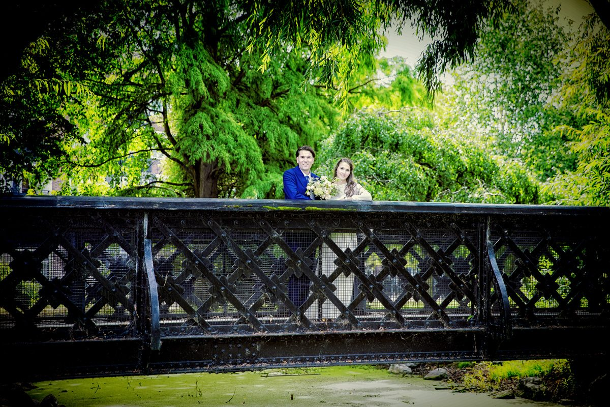Wedding couple on Clissold Park Bridge after Stoke Newington Town Hall