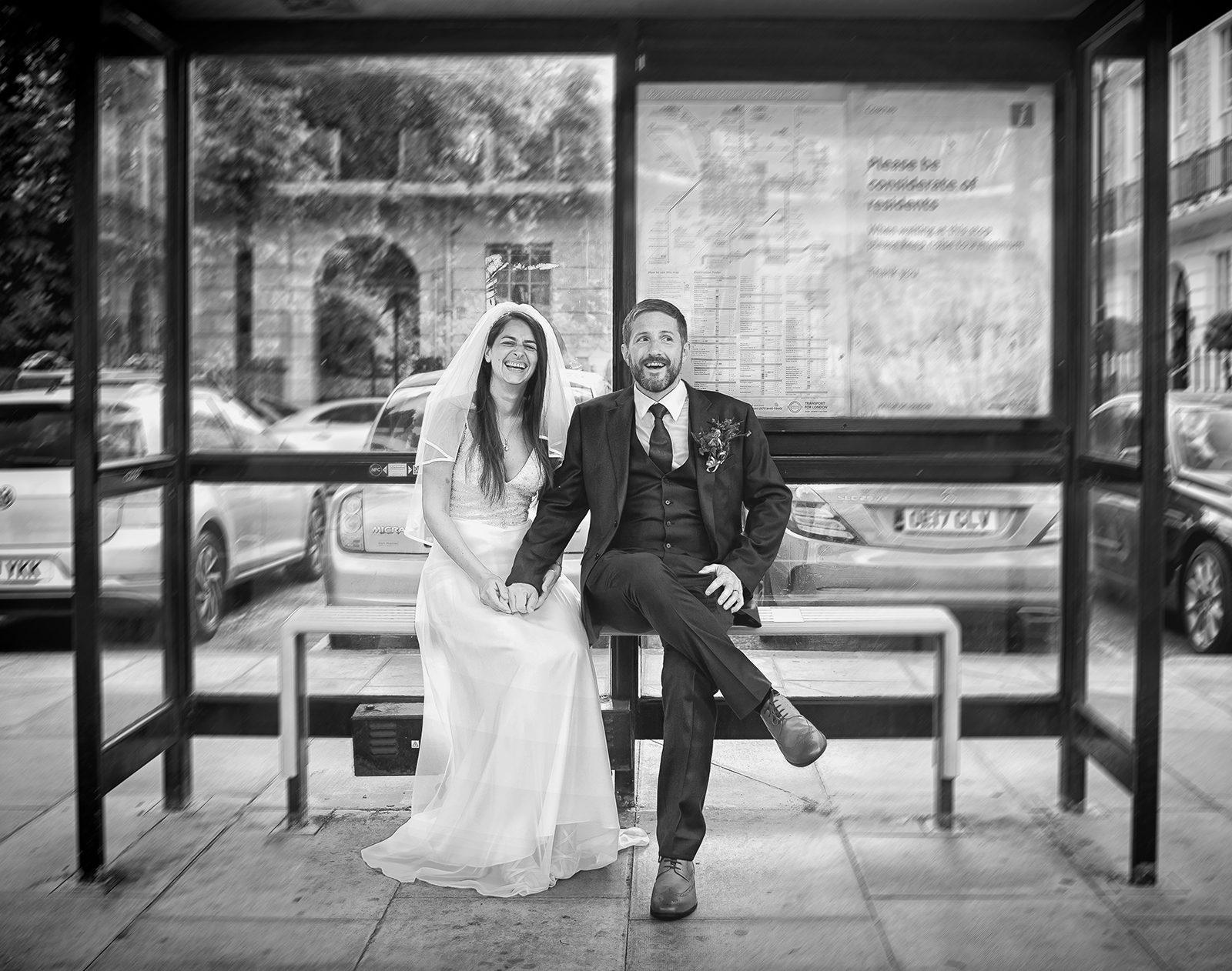 London-wedding-couple-pose-sat-in-bus stop